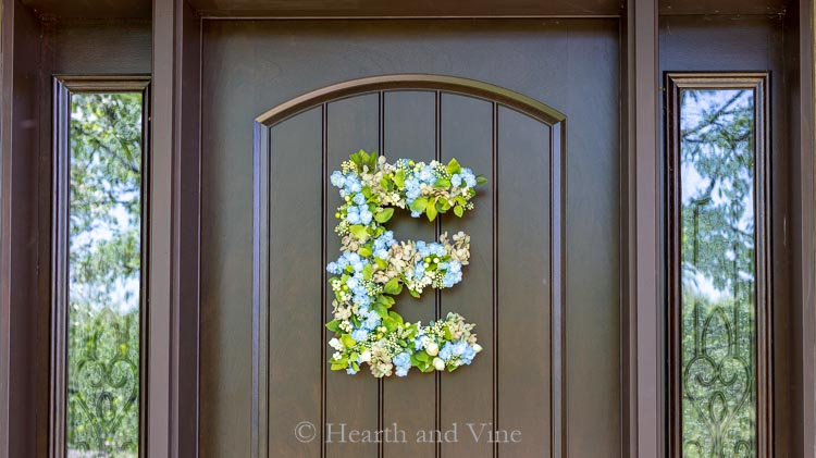 Floral letter E on front door