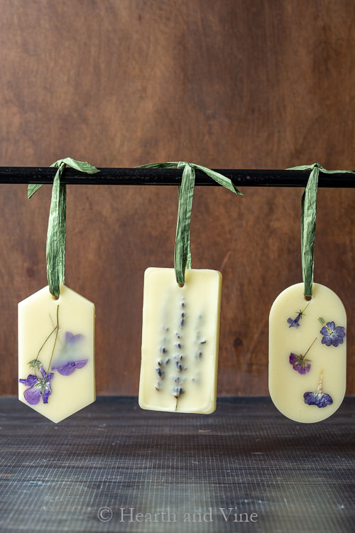 3 homemade fragrant sachets hanging on a rod