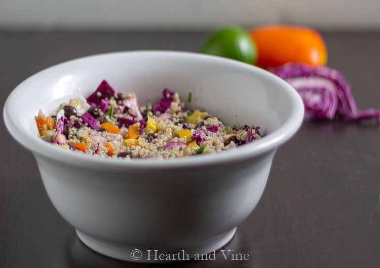 Quinoa salad with black beans, cabbage and peppers