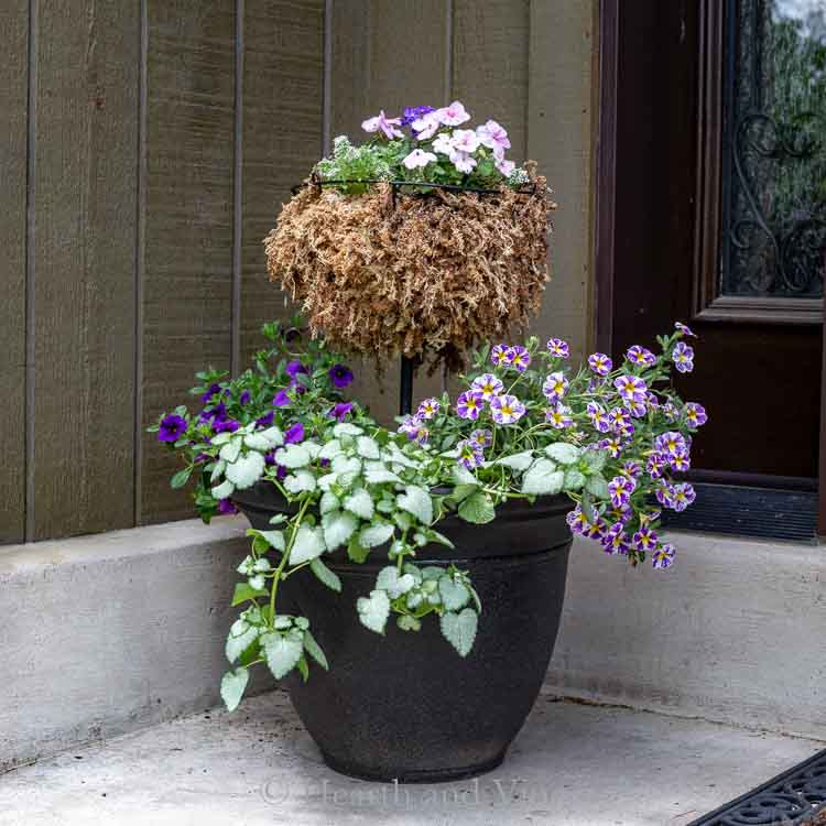 Two tiered flower planter on porch