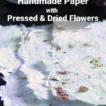 Sheet of handmade paper with pressed flowers