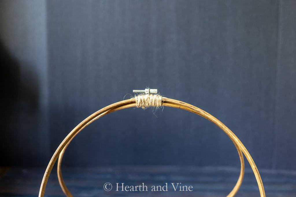 Top of embroidery hoops tied with twine
