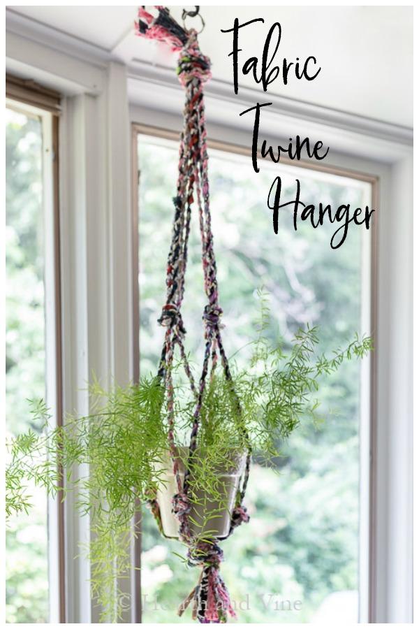 Asparagus fern in fabric twine hanger