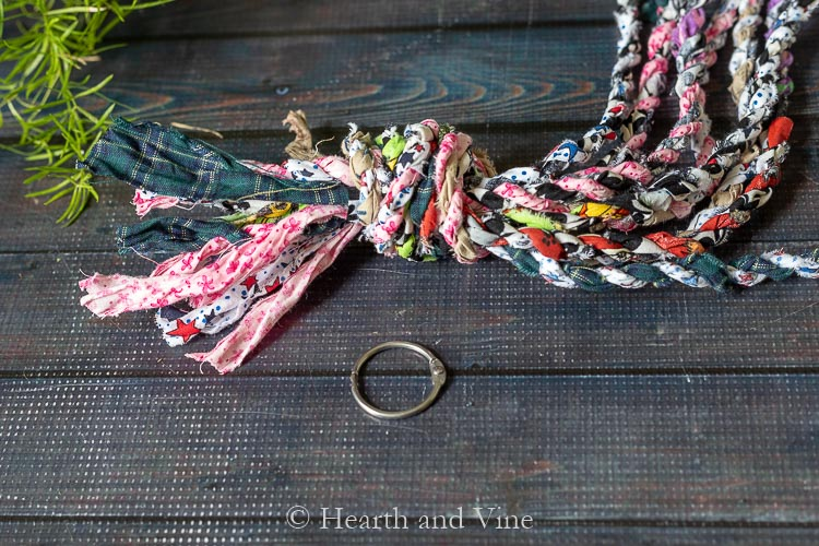 Top knot of fabric twine hanger with metal ring