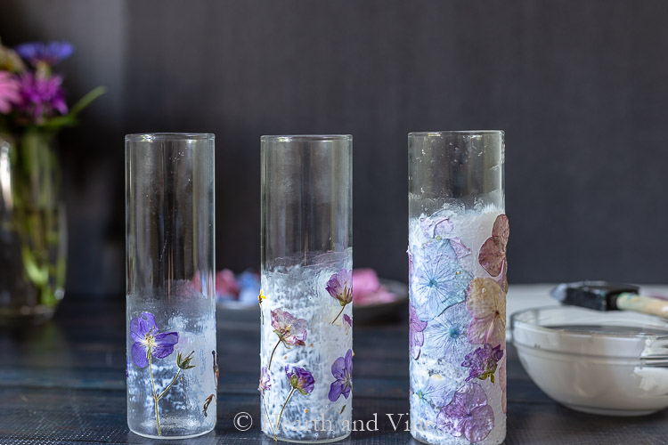 Three vases with pressed flowers and mod podge