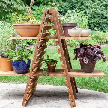 Outdoor wood plant stand on patio