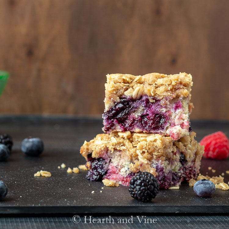Servings of triple berry buckle stacked