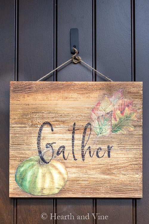 Gather wood sign on door