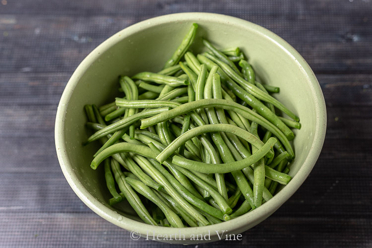 Raw green beans in bowl