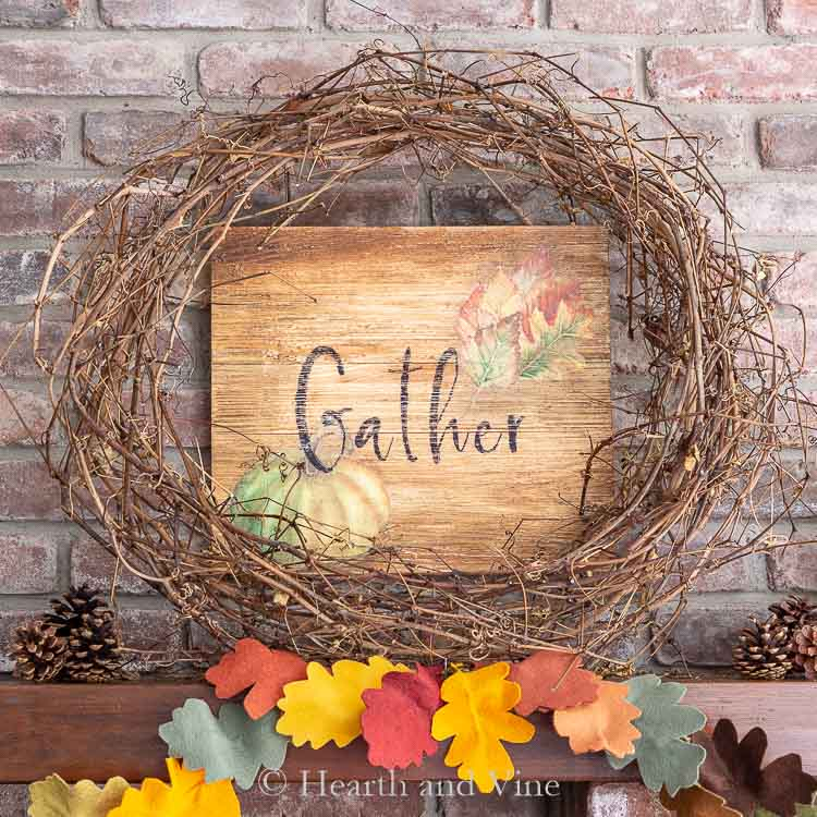 Gather sign behind grapevine wreath