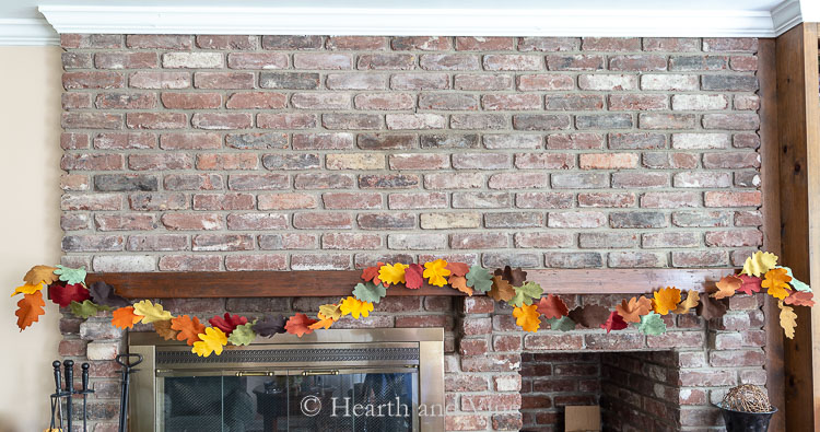 Fall leaf garland DIY complete and hanging on mantel.