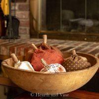 Bowl of fabric pumpkin sachets on coffee table