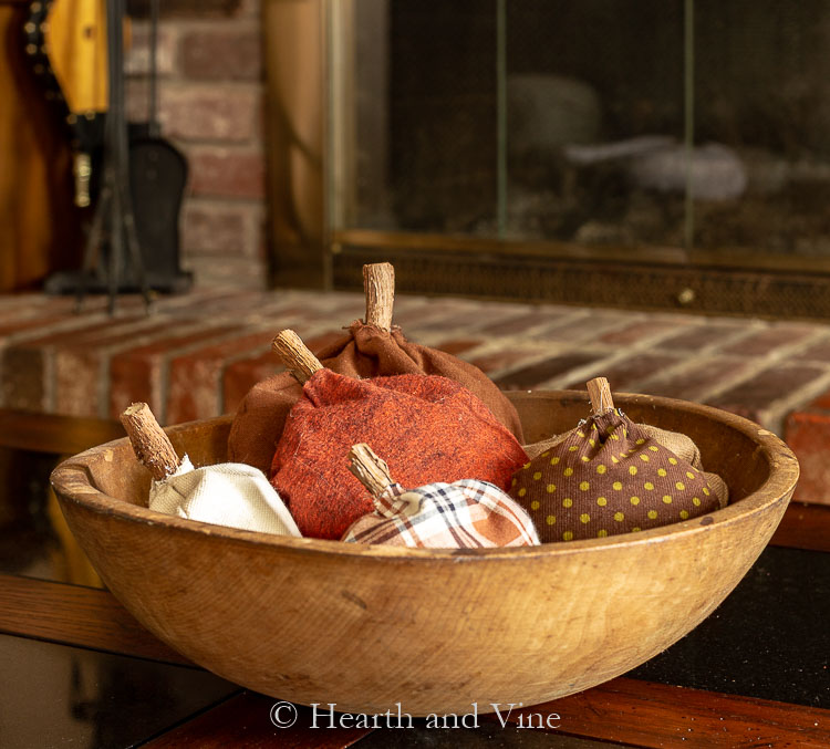 Bowl of fabric pumpkin sachets on coffee table