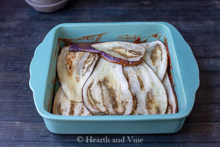 layer of eggplant in pan