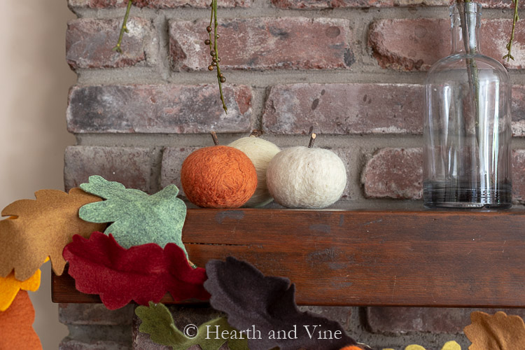 Fall mantel with felted pumpkins