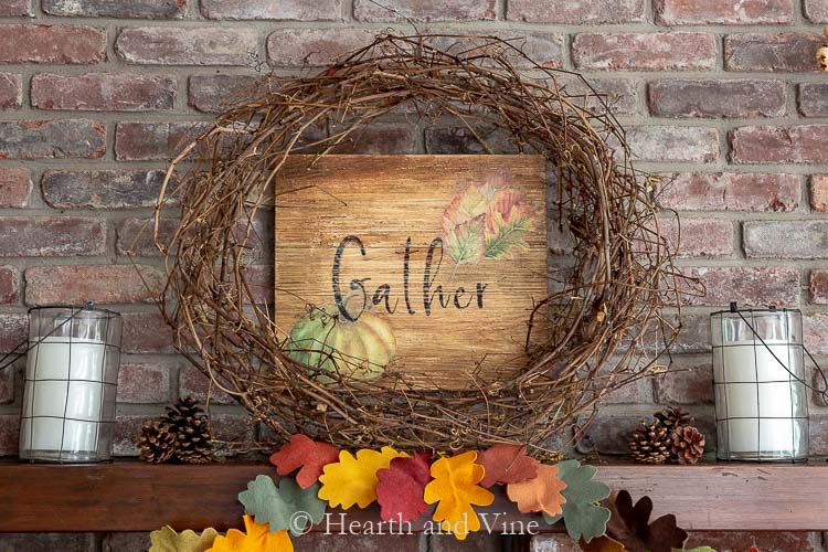 gather wood sign behind grapevine wreath