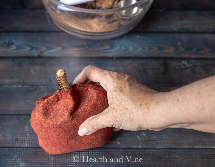Vine stem glued in top of pumpkin sachet