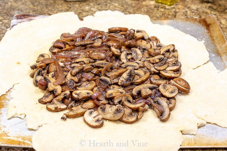 Cooked mushrooms & onions on crust