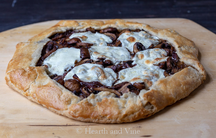 Mushroom galette on pizza peel