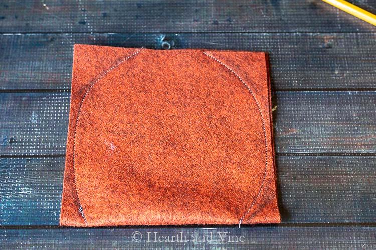 pumpkin shape sewn on felt