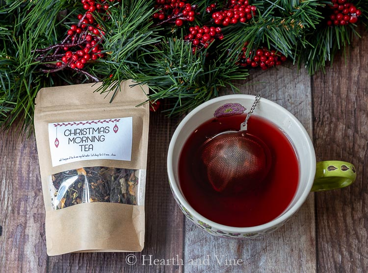 Bag of Christmas morning tea blend and teacup with tea and tea ball