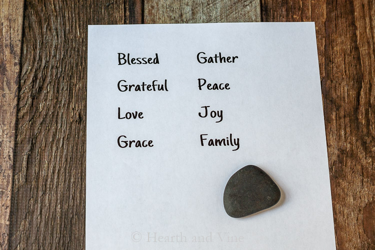 Thanksgiving words on paper and black stone