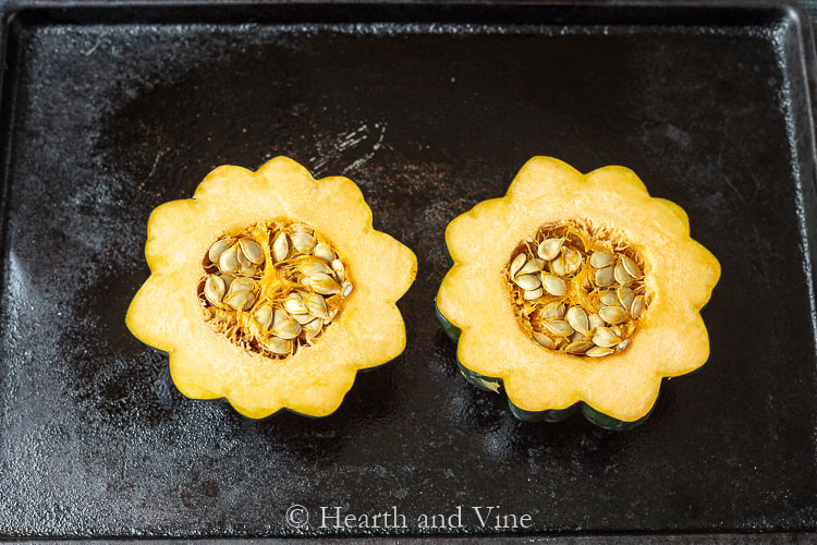 Acorn squash cut in half with seeds