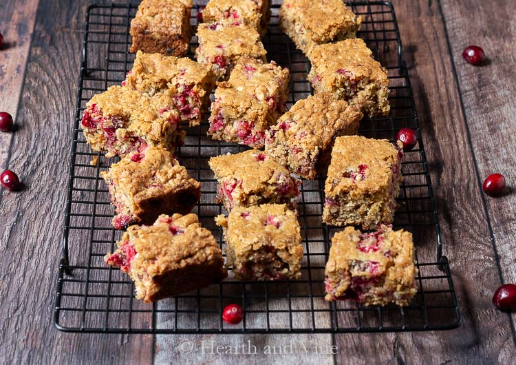 Fresh cranberry oatmeal bars on a cooking rack