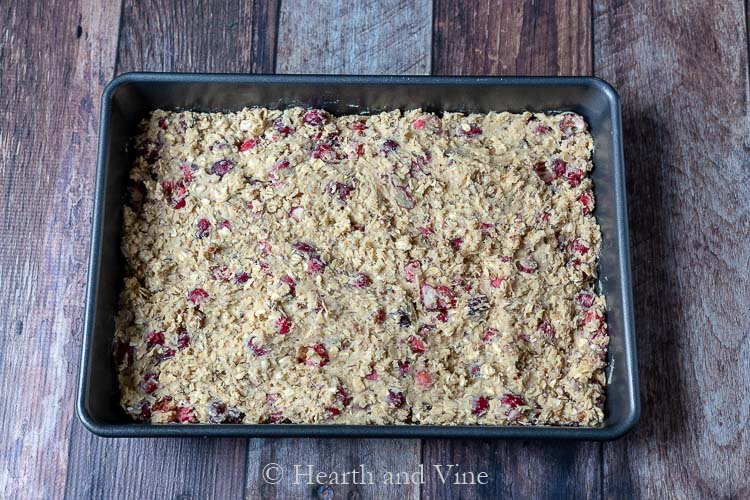 Cranberry oatmeal bar batter spread into a pan