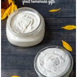 Two jars of body butter and a few sunflower petals.