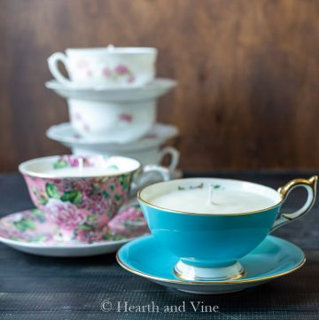 Blue teacup candle and pink in background
