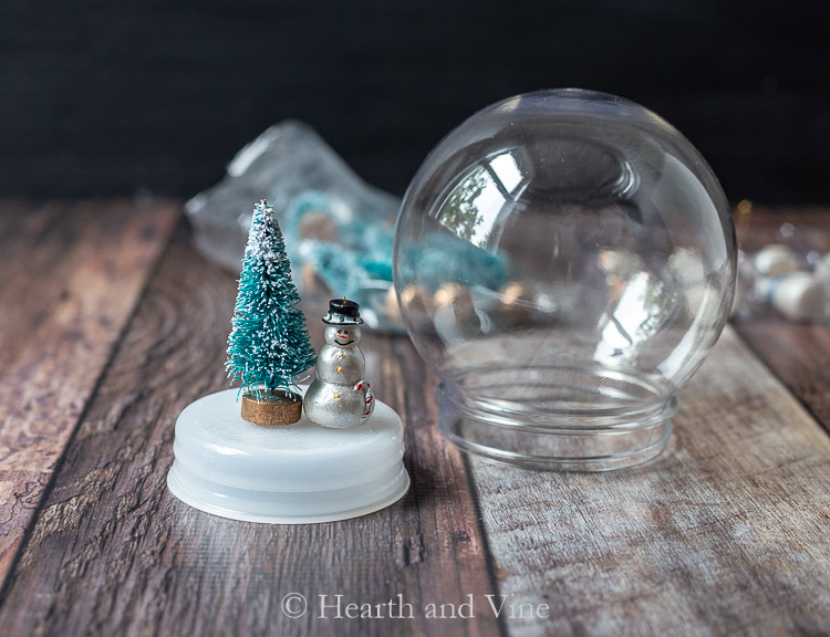 Glued ornaments to base of snow globe