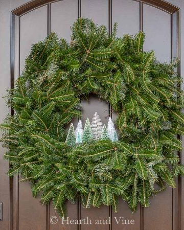 Bottle brush trees in an evergreen wreath