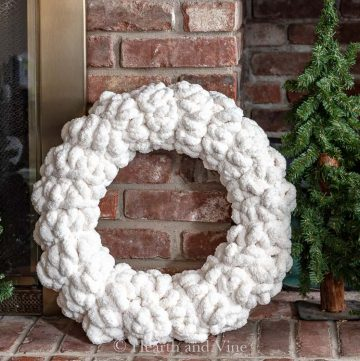 Chunky yarn wreath on hearth
