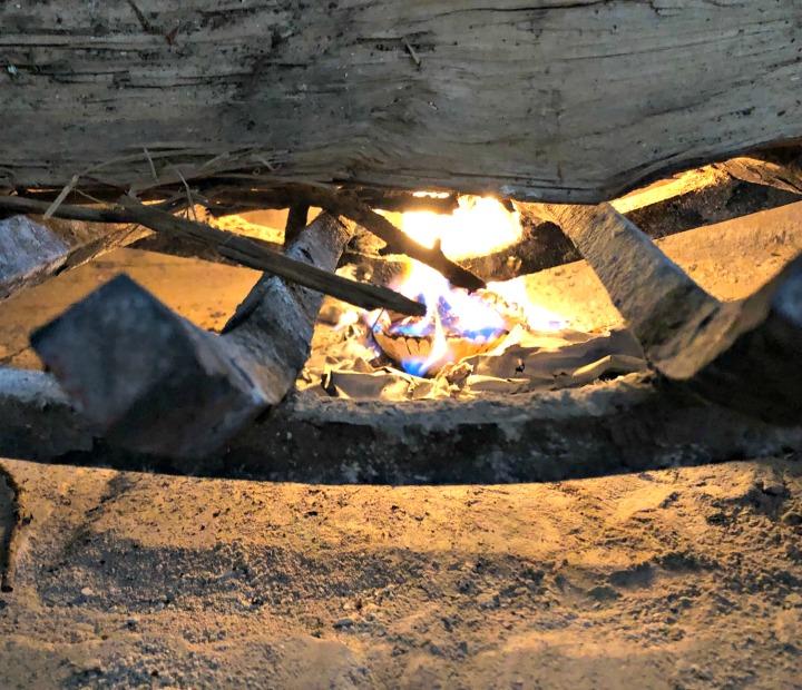 Fire starter on fire in hearth