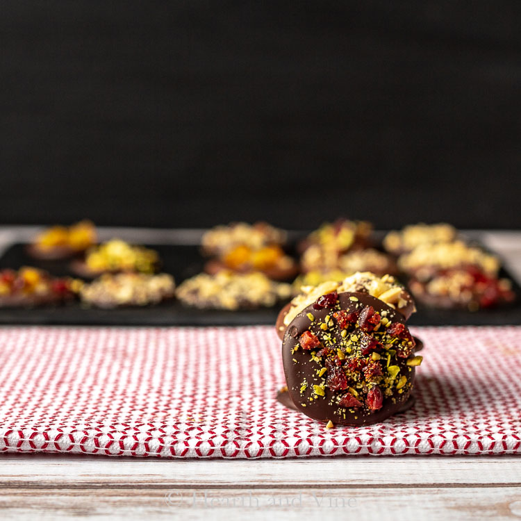 Homemade chocolate candy drop with pistachios and cranberries