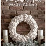 White yarn wreath on mantel with candles