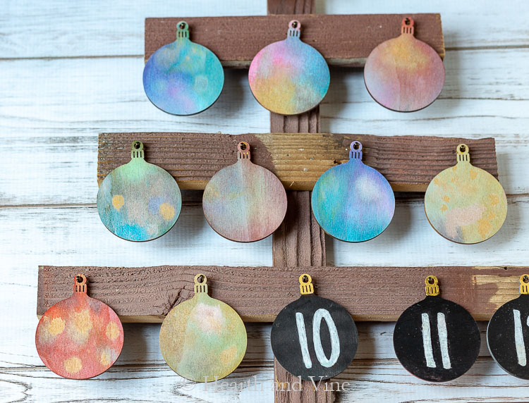 Mix of colored ornaments and number ornaments on advent tree