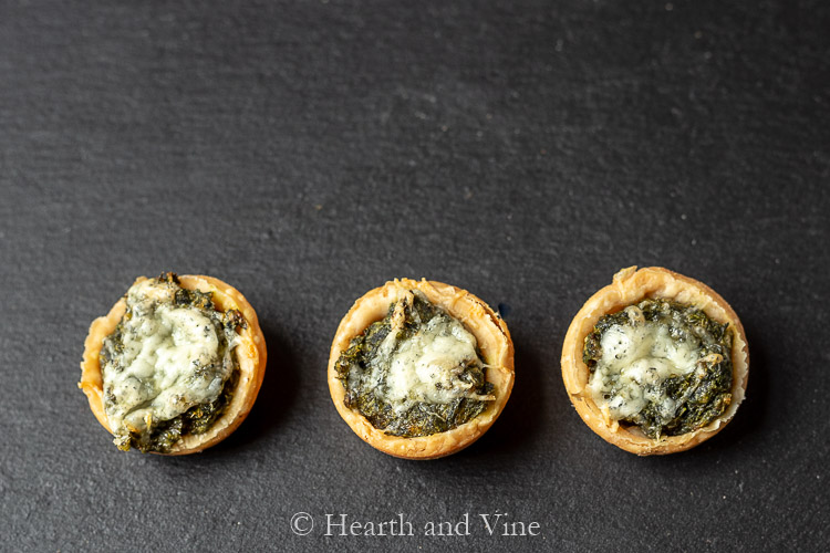 Trio of spinach and cheese muffin cups on board