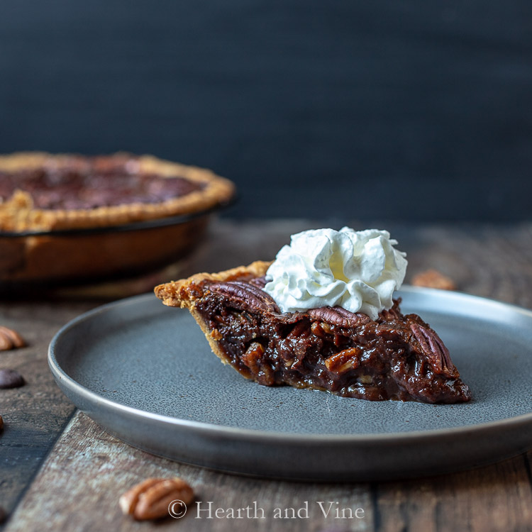 Slice of chocolate pecan pie