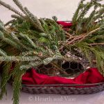 Layering evergreen branches in basket