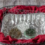 Wire basket with red fabric, foil tin, flower frogs and chicken wire