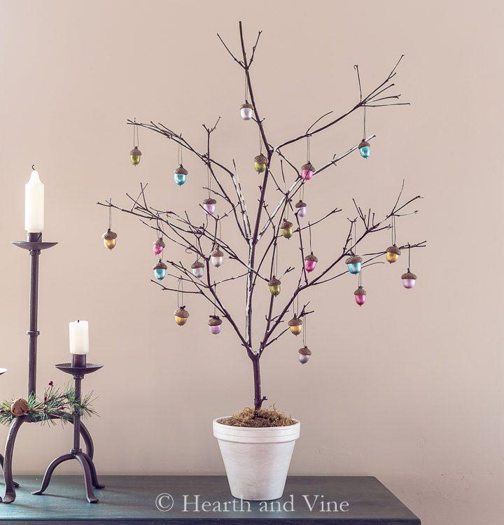 Branch Christmas tree with metallic acorn ornaments