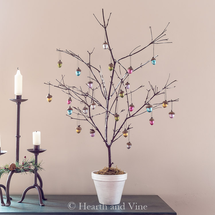 Branch Christmas tree with metallic acorn ornaments
