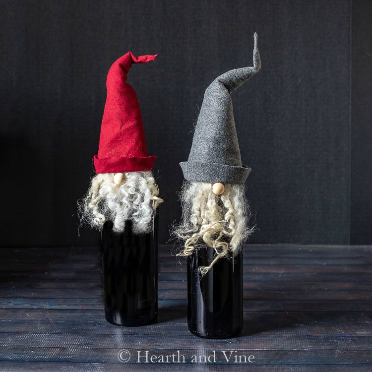 Two gnome wine bottle toppers