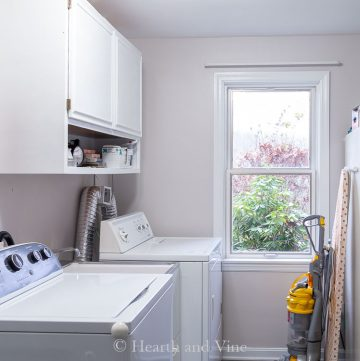 Laundry room cabinet and window painted white