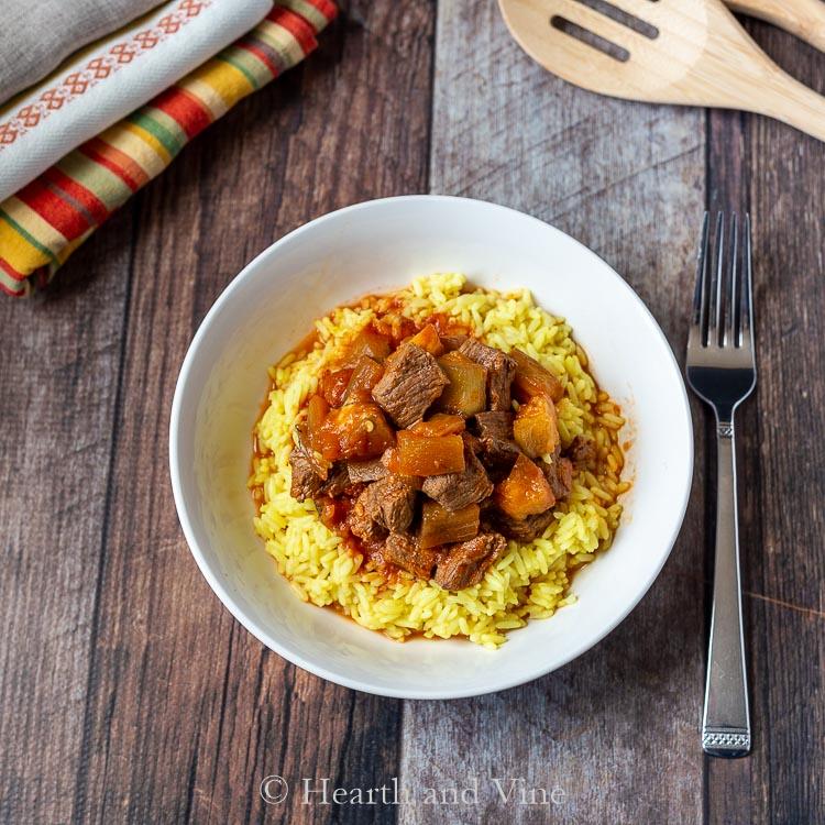 Eggplant beef stew on turmeric rice