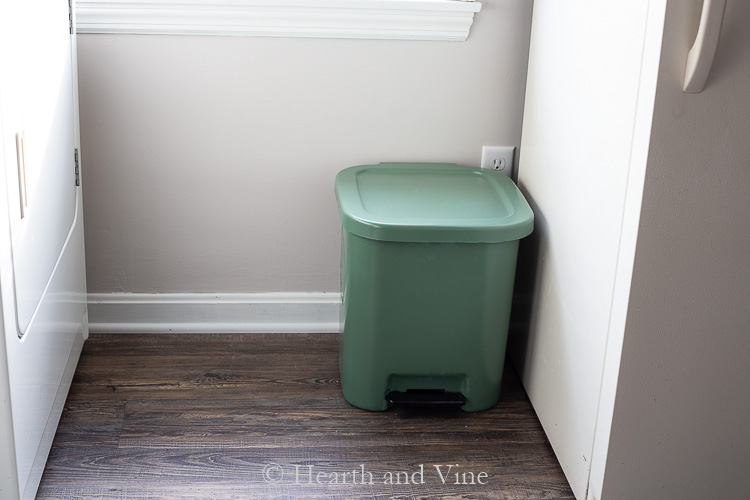 Spray painted green garbage can.