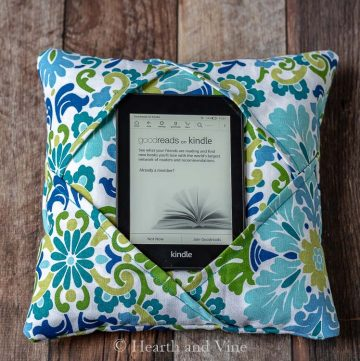 Kindle holder on table