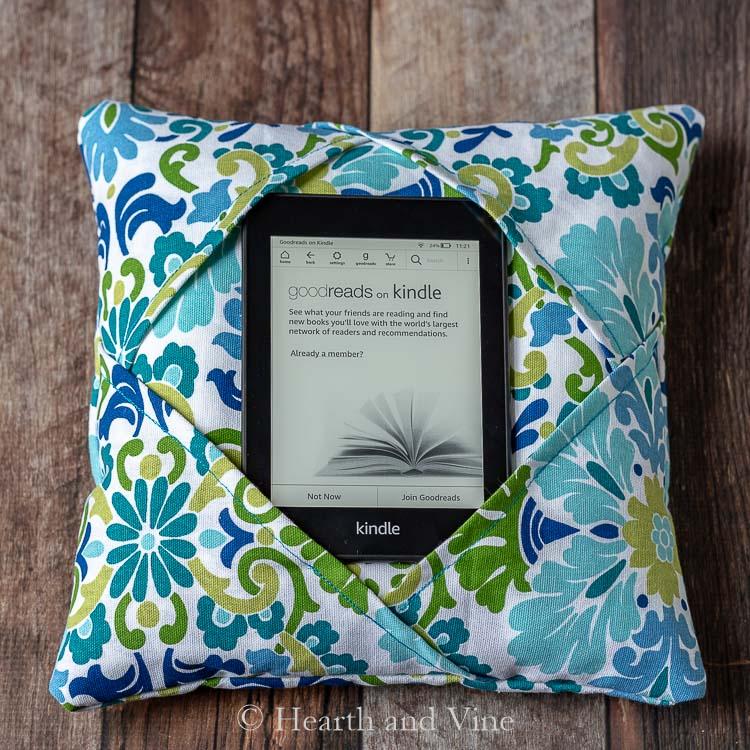 Kindle holder on table